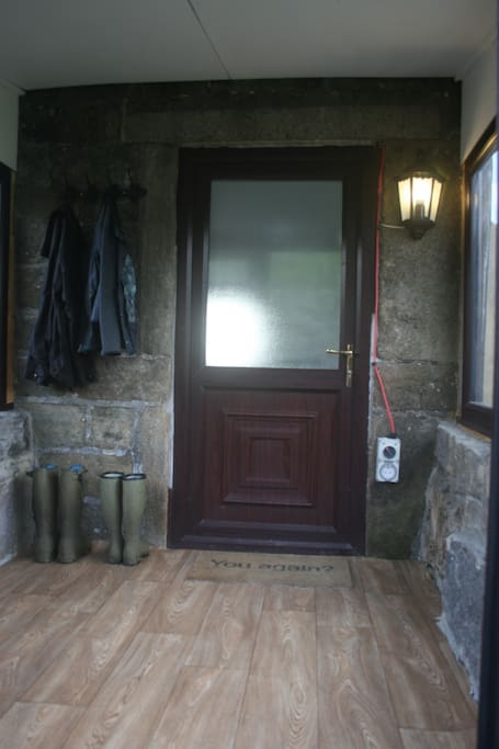 Boot room and cycle storage, in entrance porch.
