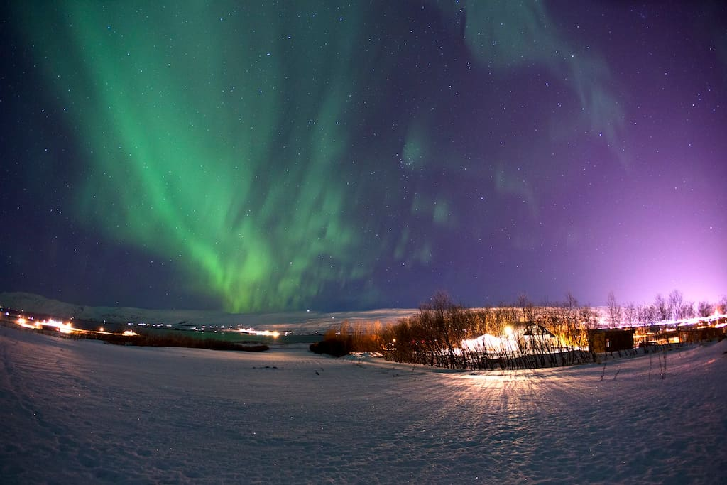 This northern light photo is taken just outside the cabin in December