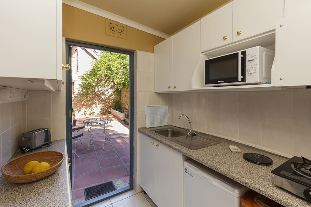 Fully equipped little kitchen, looks out onto the courtyard