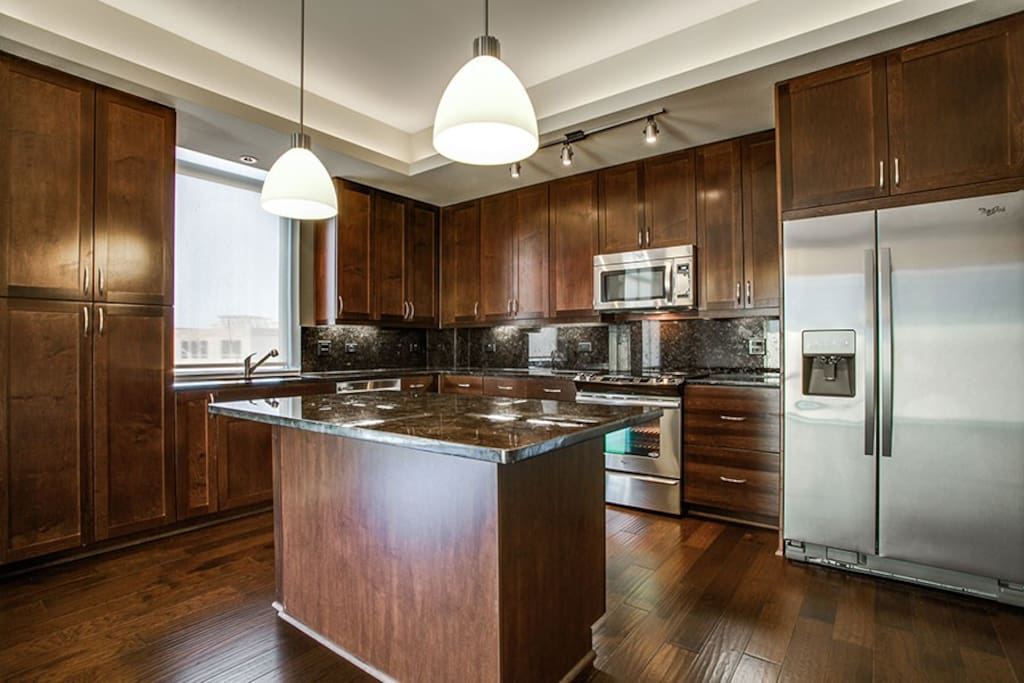 Representative of the kitchen but not exactly the same. The pictures are representative and close, but decor and exact space is slightly different than pictured. Quality is on par with pictures.