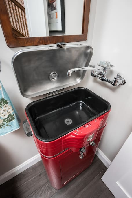 Half bath on main floor sports this funky vanity fashioned out of an old roaster oven.