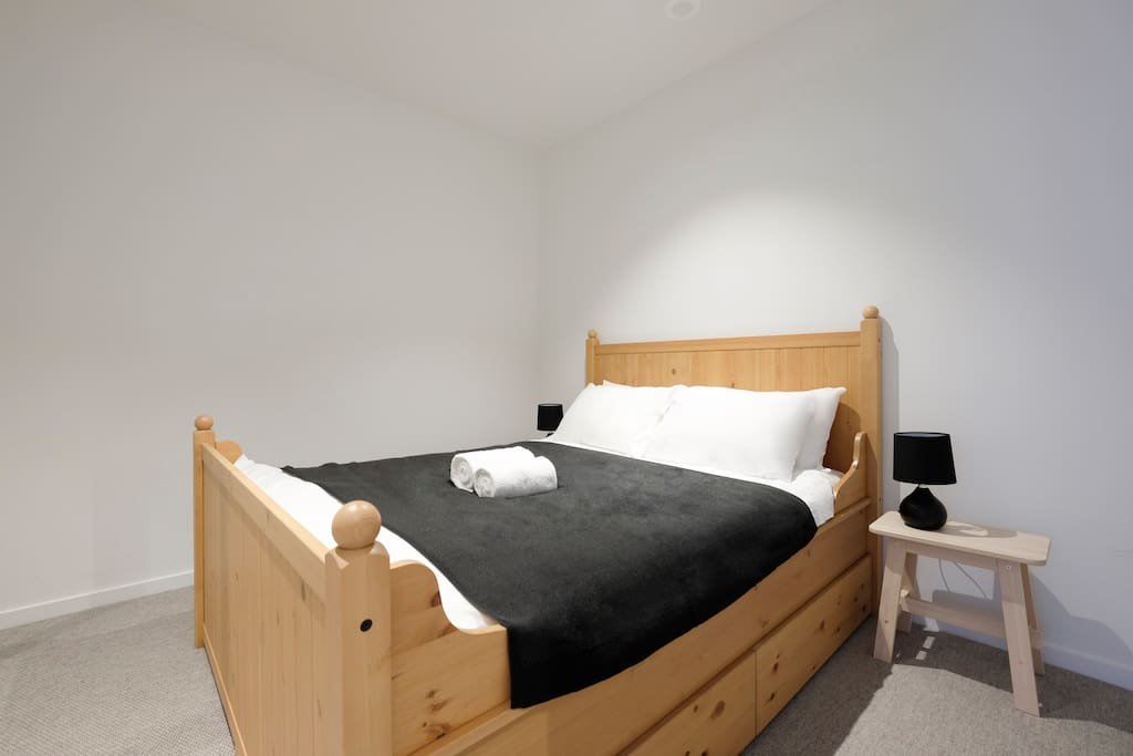 Queen size bed for a relaxed sleep. Turn on the side lamp to enjoy your late night read.