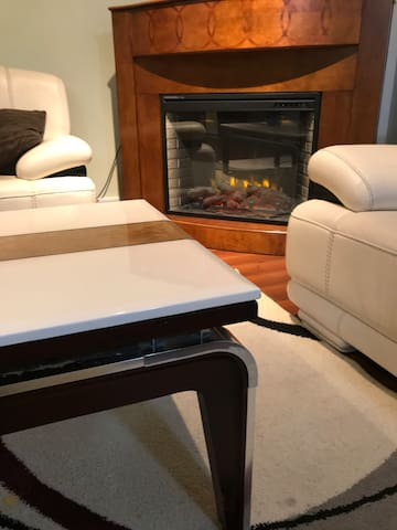 Private guest area   sofa & fireplace