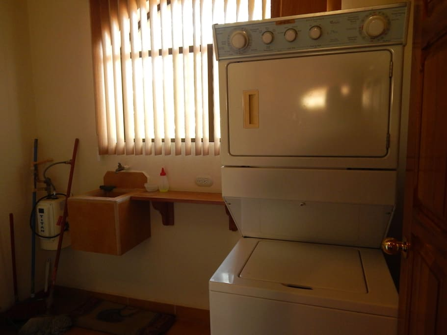 Condo has a laundry room with a washer and dryer