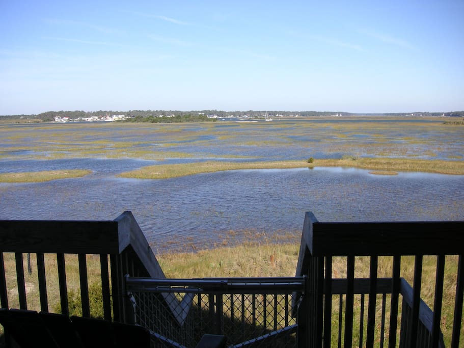 Expansive marsh and waterway views to the rear