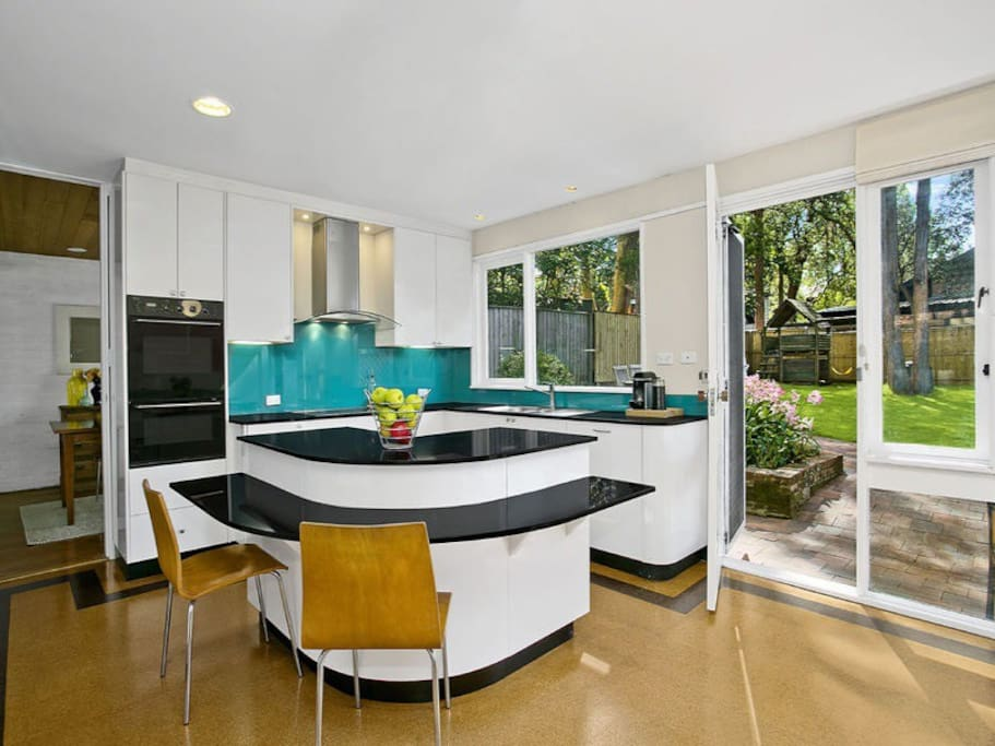 Open plan kitchen, near the play room and with views out to the backyard.