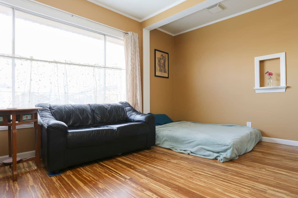 Here is the living room with a queen bed