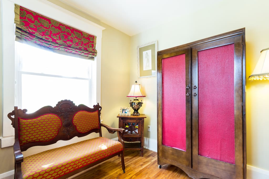Large armoire across from the front door and additional seating.