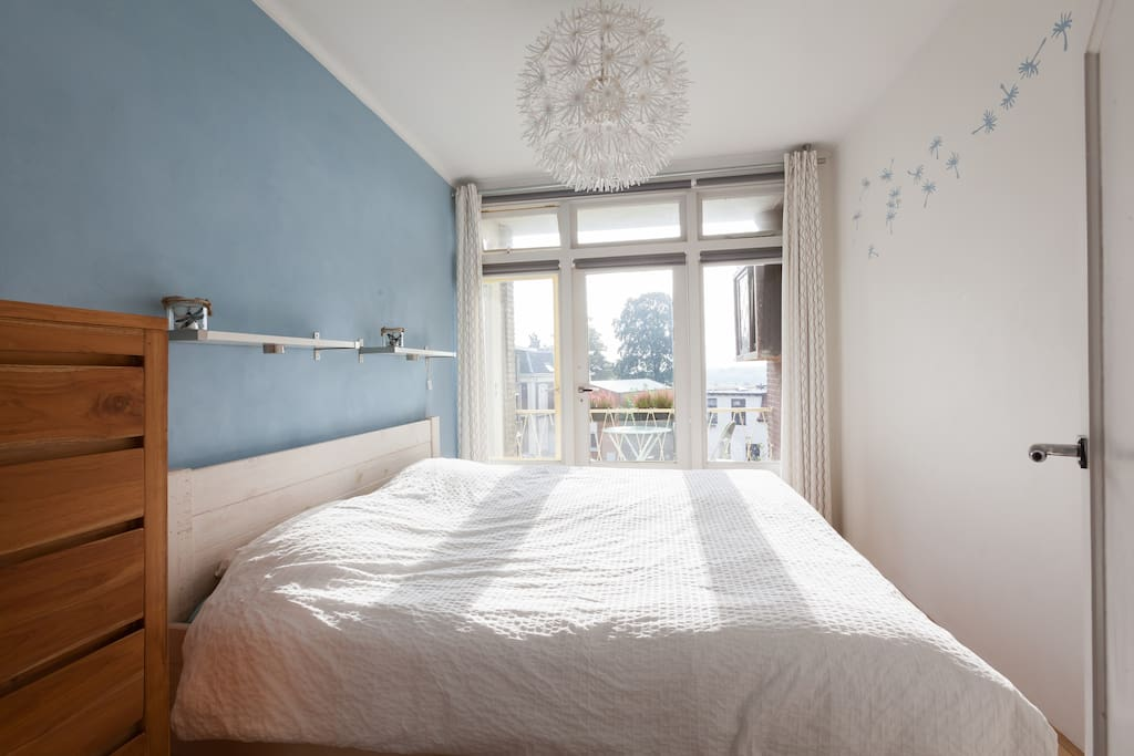 Bedroom with morning sun and double curtains