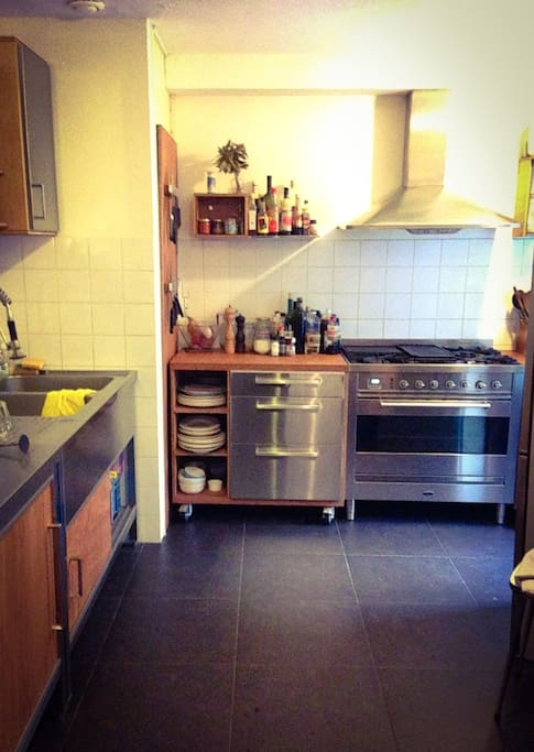 Huge kitchen with great kitchen tools and Boretti stove