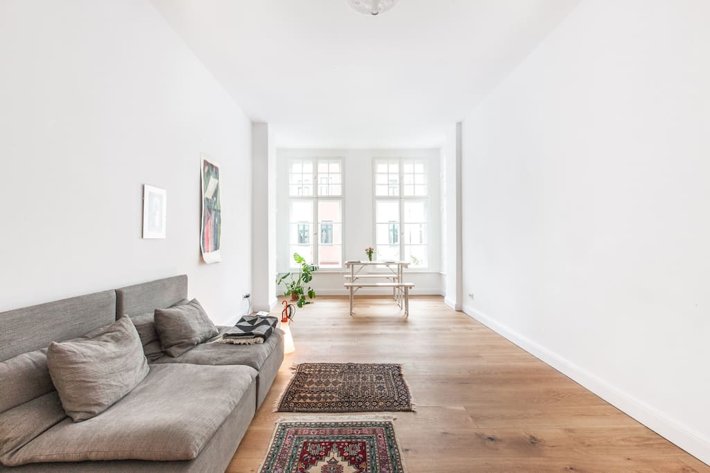 Oak floor boards with heating set the tone of the appartment