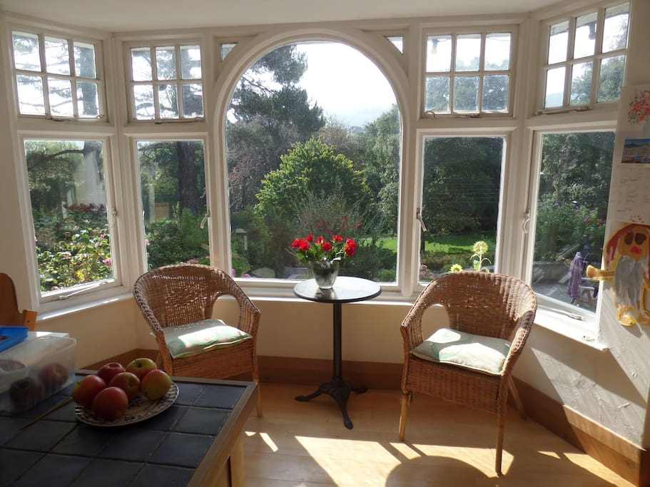 Bay window seating area with beautiful views over the hills. Warm and bright on a winters sunny morning.