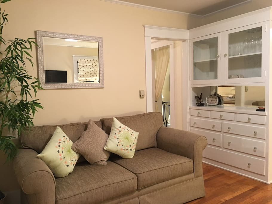 Living area with sleeper sofa and built-in hutch.