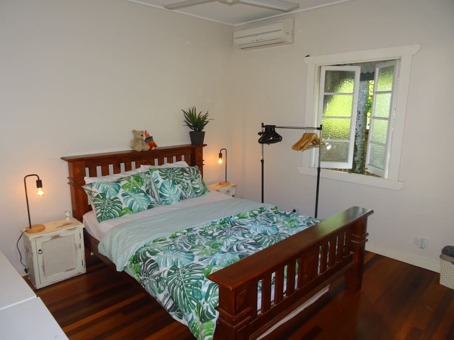 This is the guest bedroom with a tropical feel and beautiful lighting