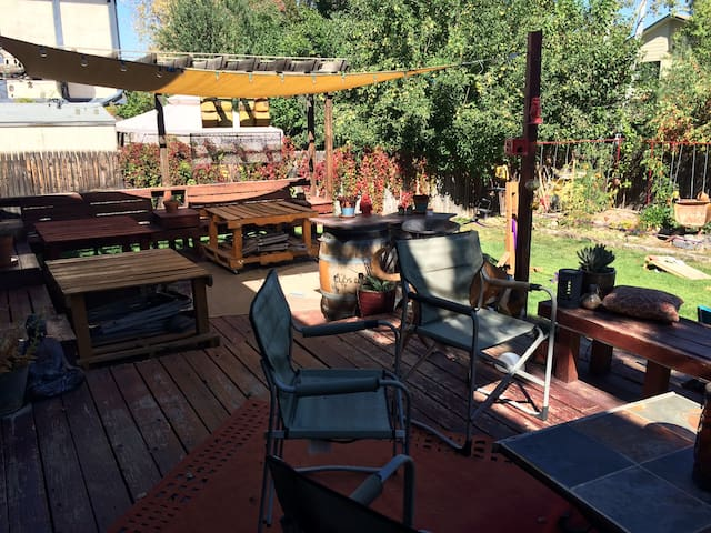Large deck with table and casual seating areas