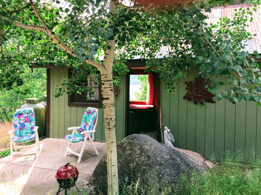 View into the Aspen cabin with picture window offering a view of the lake