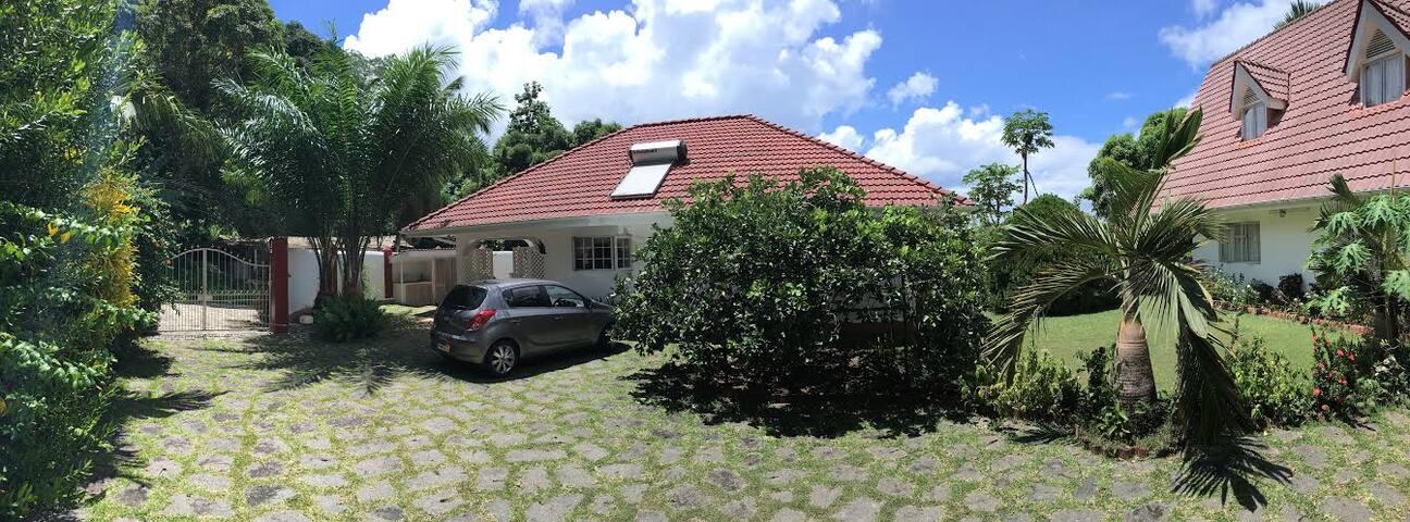 Entrance and back of villa