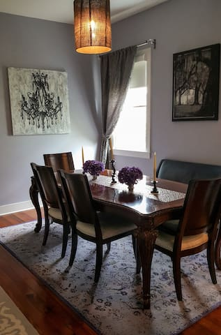 """The """"oyster palace"""" dining room is atmospheric, elegant and full of grace.  Separate dining rooms are rare in homes like these - ours is perfect for a holiday meal!"""