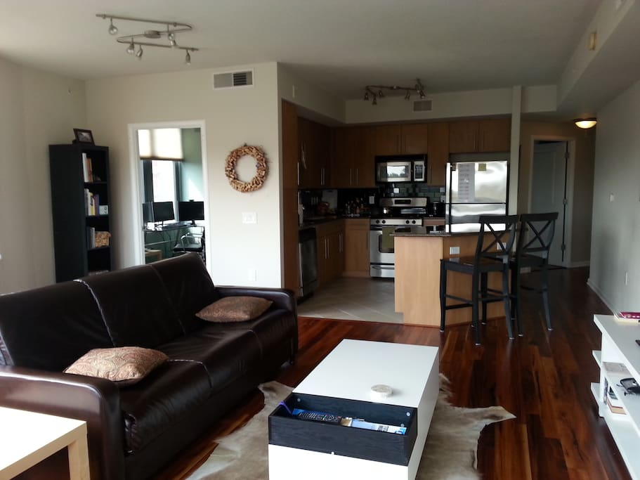 Free standing island, gas stove, stainless steel appliances.