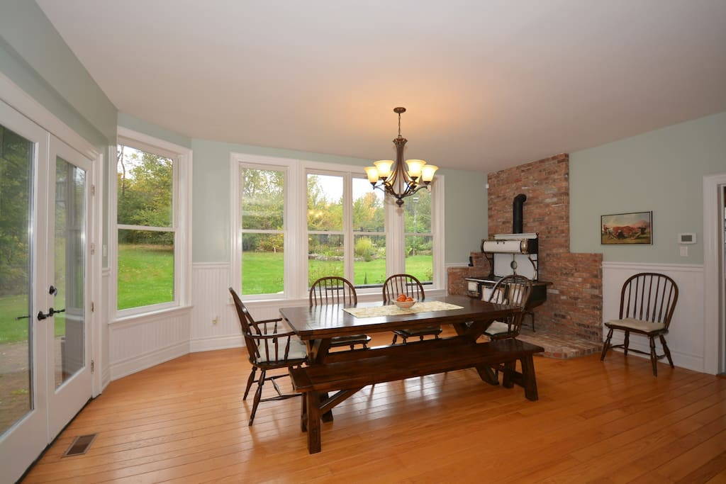 Country Dining Room with Antique Stove.  Great view of property