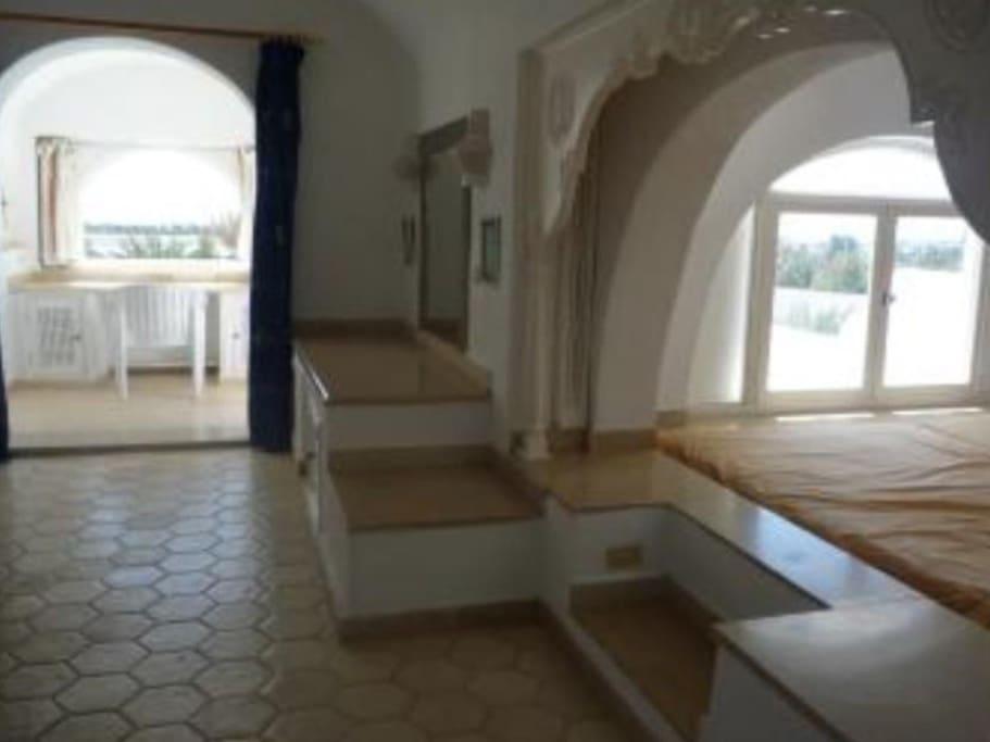 Suite avec terrasse sur mer et piscine et vue panoramique