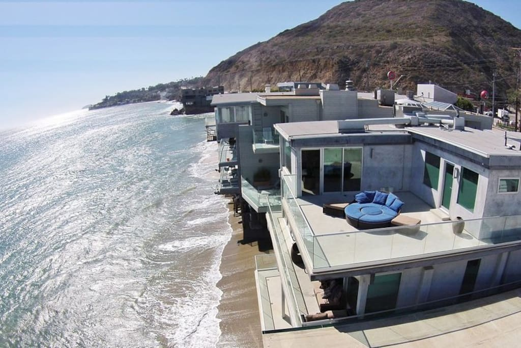 aerial view of large sun deck off master bedroom