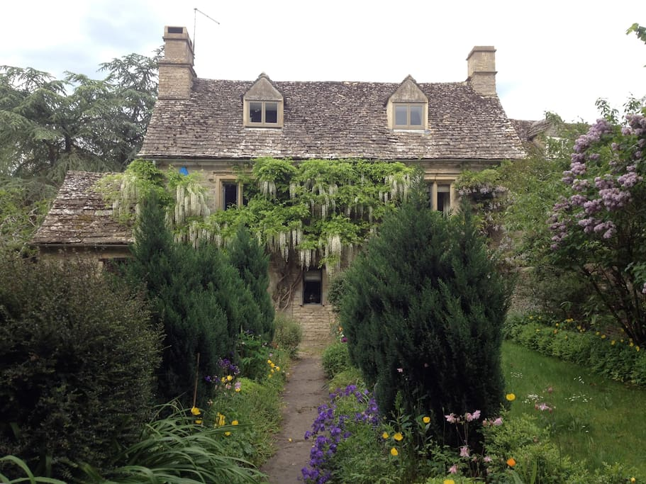 Front of the property with formal English gardens.