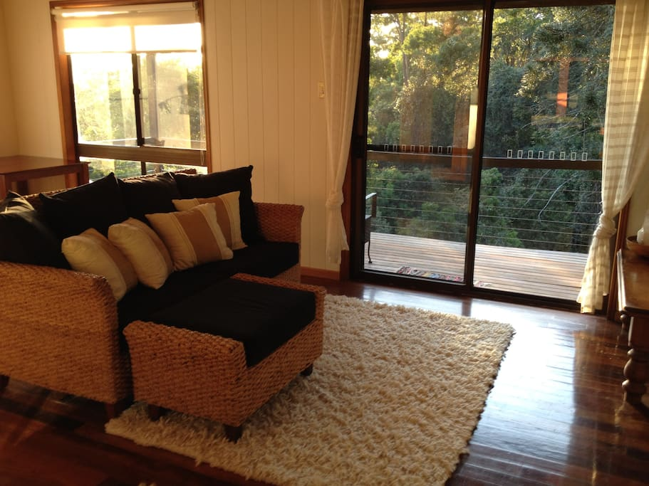 Sitting room with views to the verandah and forest