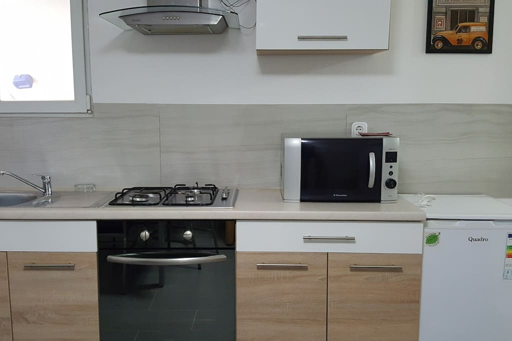 Kitchen with an oven/cooker and microwave