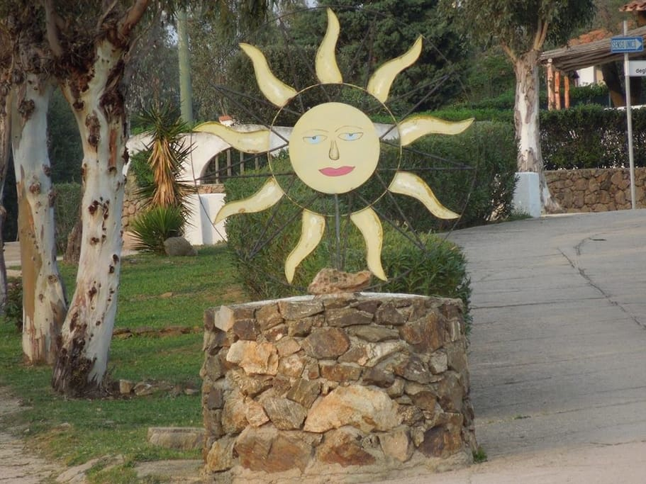 Entrance to Lido del Sole Village with it welcoming yellow Sun iron sculpture