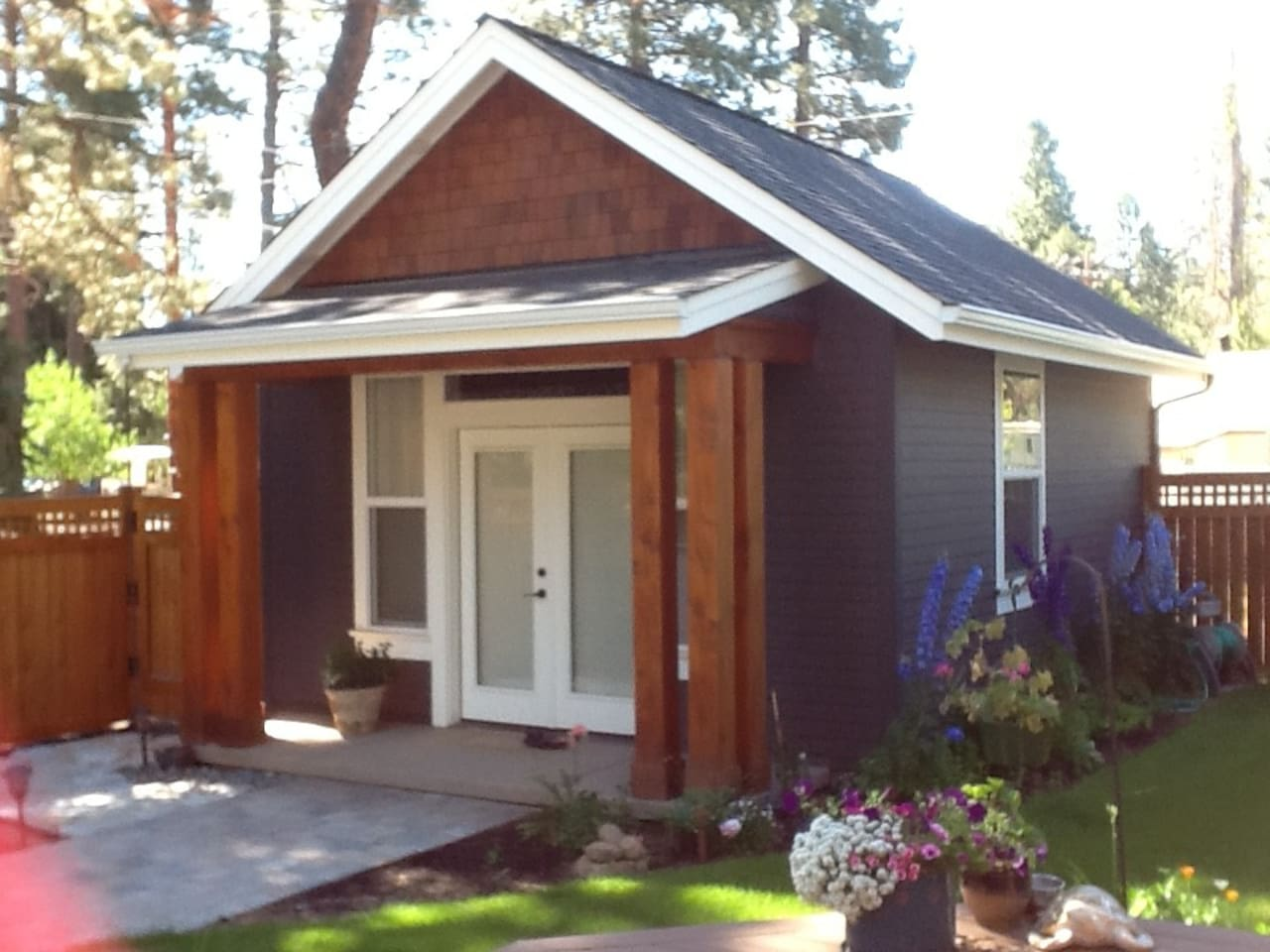 Private studio suite with full bathroom and kitchenette in shared backyard.