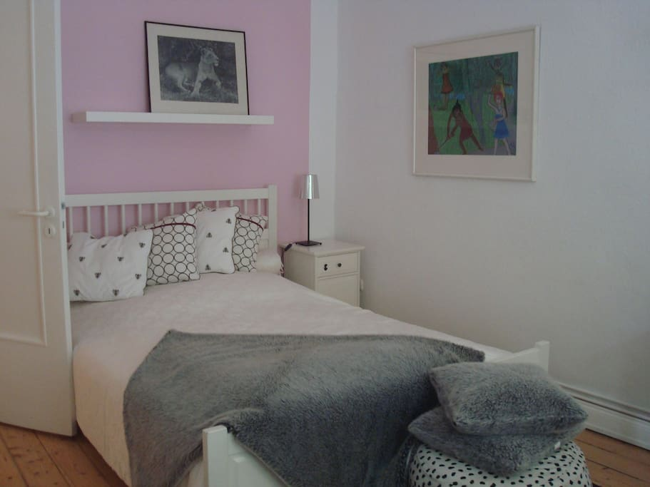 Cosy bedroom with double bed and big built-in wardrobe