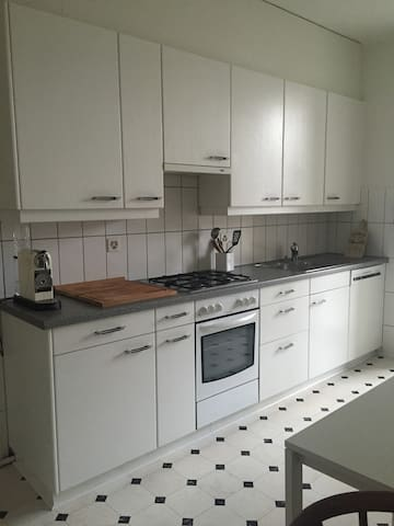 Kitchen equipped with gas stove, oven, dish washer, nespresso machine, water boiler, blender..