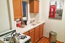 Full kitchen, stove, microwave, and fridge (with some snacks for you ;)