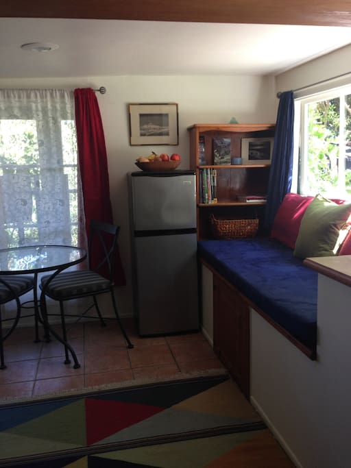 Bistro table and chairs, fridge with freezer, day bed that looks out to the lovely entry garden.