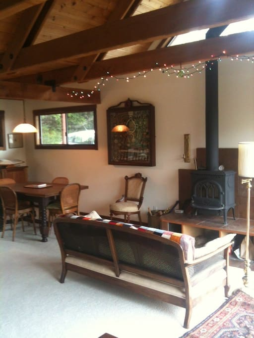 Sofa facing the wood stove, for cooler coastal evenings.  To the left is the dining area, to the right is the view.