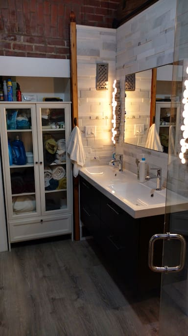 In-suite bathroom with all the amenities, including laundry and steam sauna.