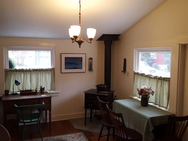Open Dining Room with drop-leaf table and desk area