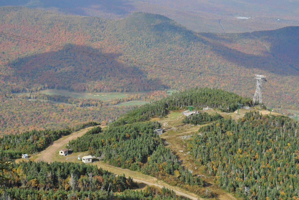 From the top of Jay Peak, with several trails in view, and the mountains beyond showing off their fall foliage goodness.