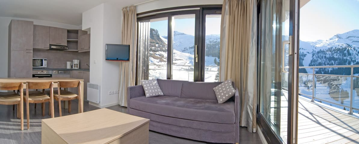 Welcome to our elegant and modern ski-in/ski-out apartment!