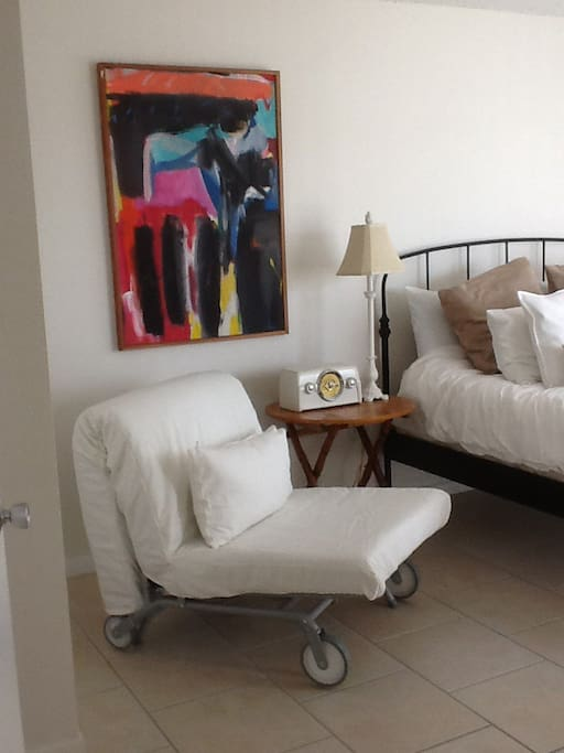 Original abstract art and spare bed