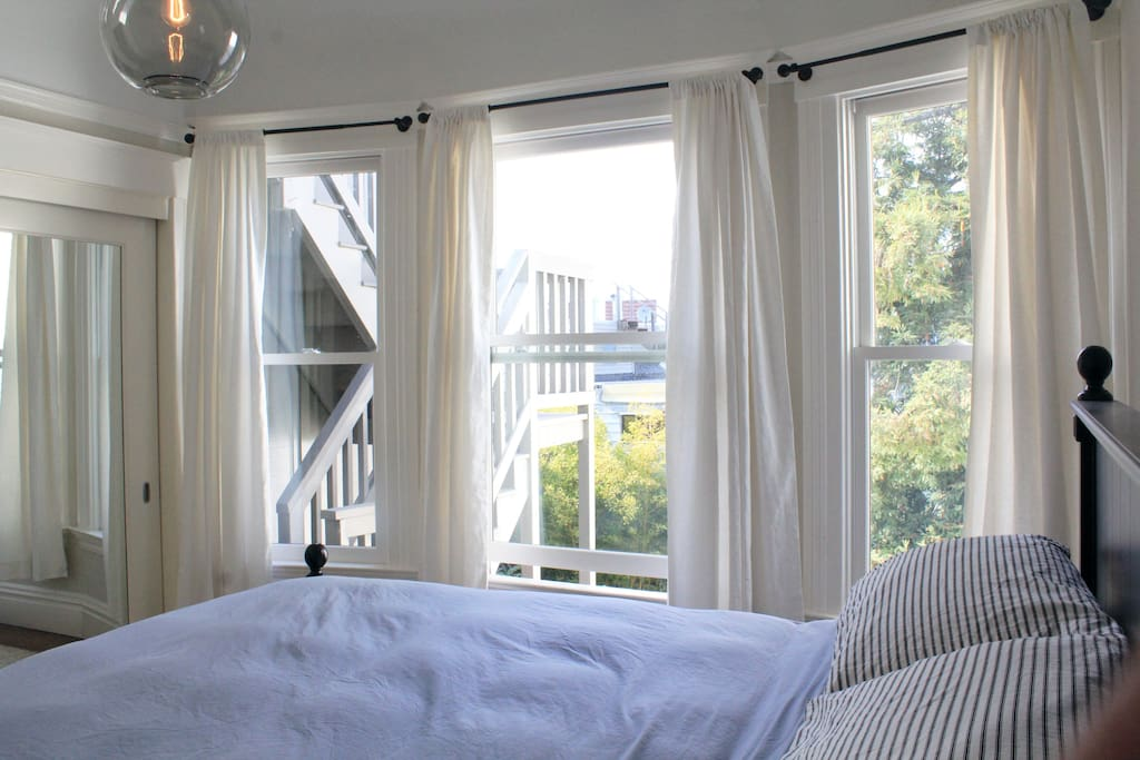 Cozy master bedroom overlooking the courtyard and view of alcatraz