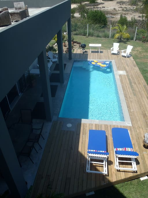 view of the pool from private master bedroom balcony