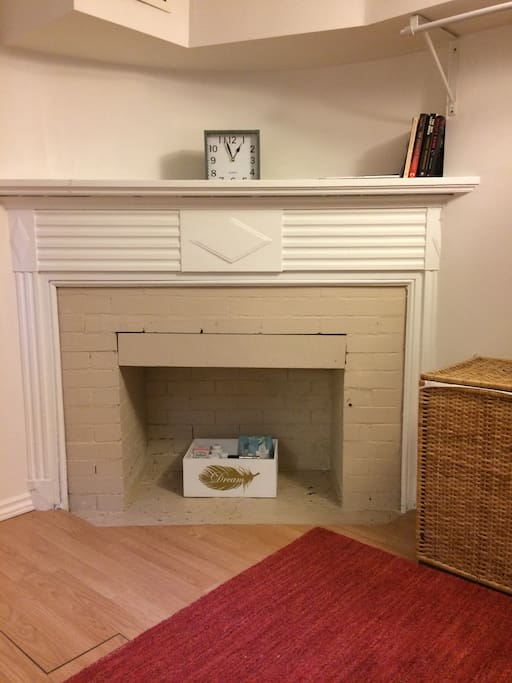 The bedroom has a sweet (non-working) fireplace that can be used for books.