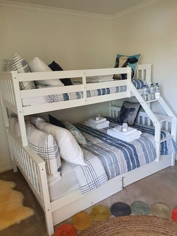 Double and single bunk bed with built-in robe.  Fan also.