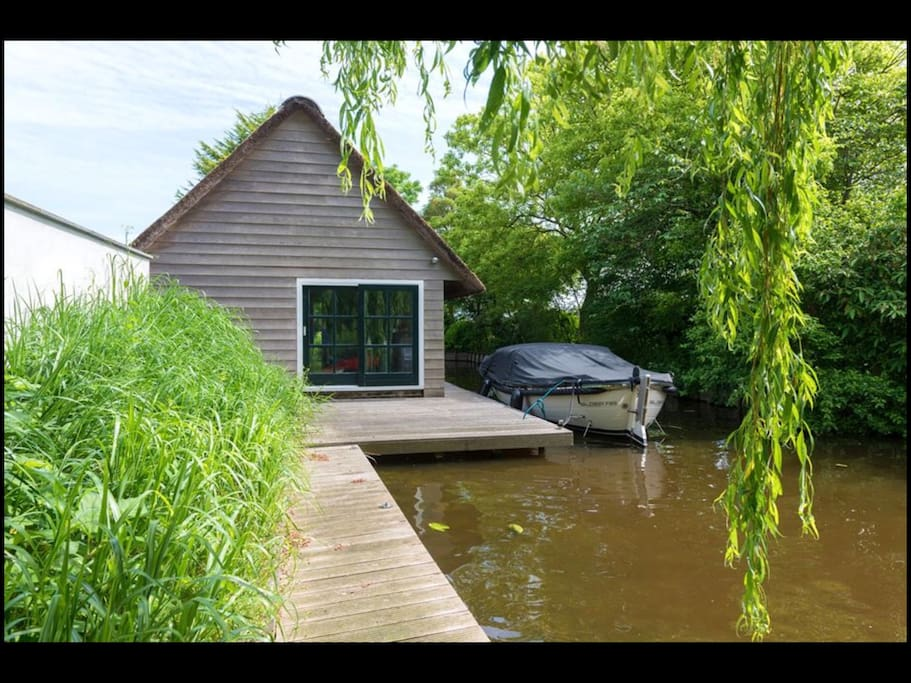 The Boathouse with terrace and jetty