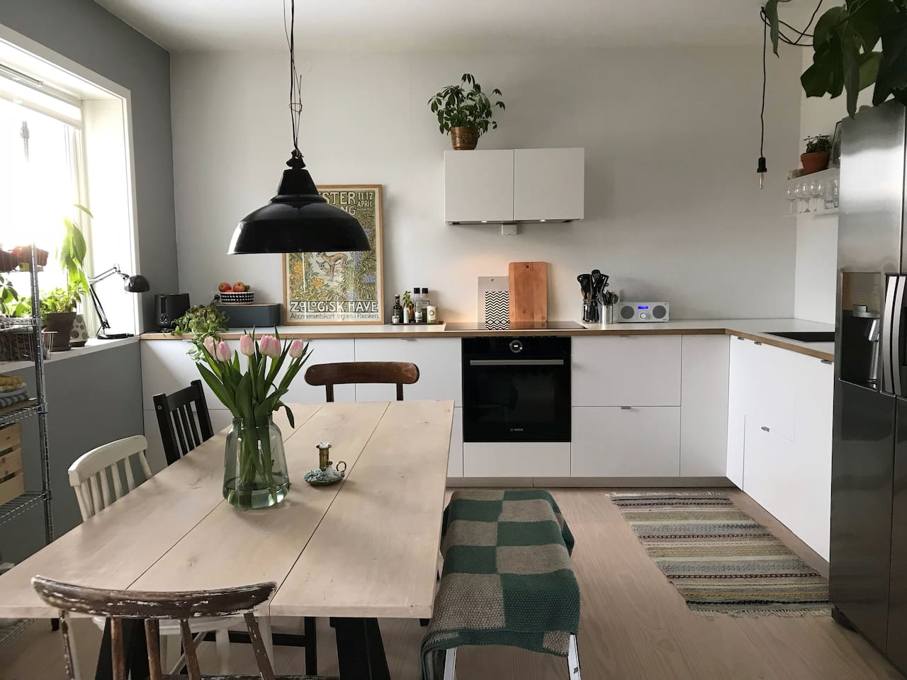 Open kitchen area with dining table - sunny from early morning!