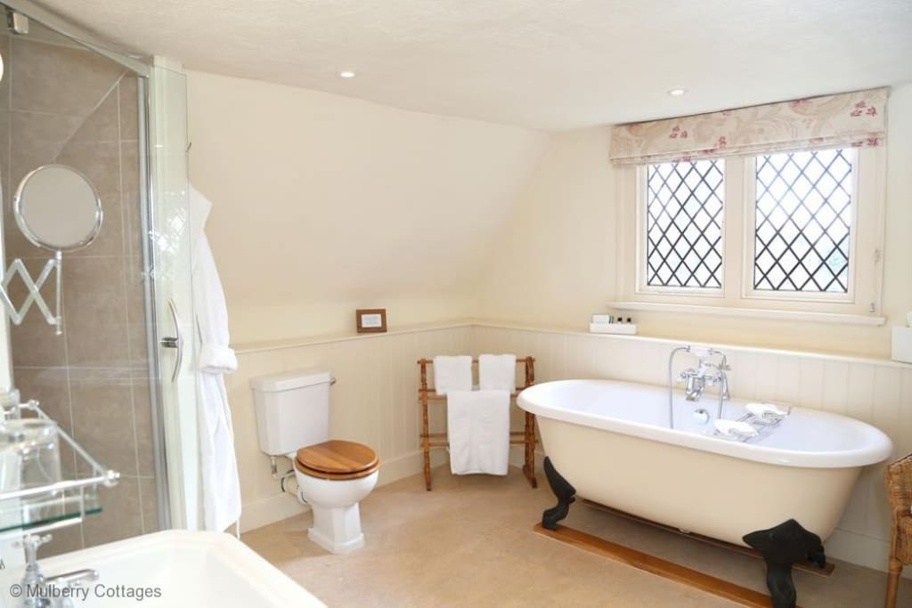 Ensuite bathroom off Bedroom 1 - Roll-top bath, separate shower cubilce, toilet & wshbasin