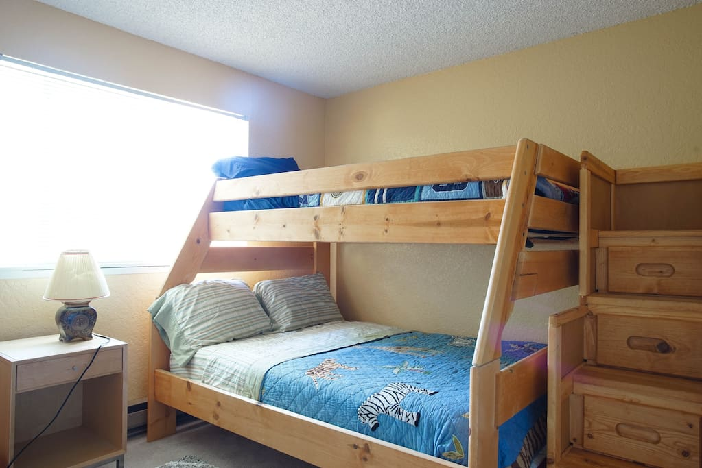 Full mattress for 2 on the bottom with a Leesa memory foam mattress. Twin bed on top with Serta mattress