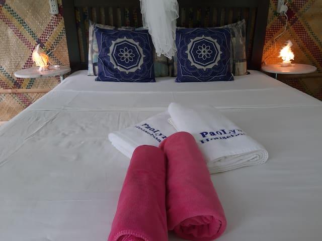 queen bed of main bedroom
